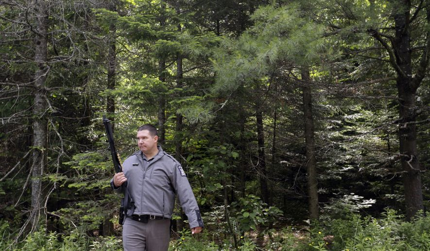 A law enforcement official stands guard on Studley Road where the search for convicted murderer David Sweat continues, Saturday, June 27, 2015, in Duane, N.Y.   Convicted murderer Richard Matt was shot and killed by a Border Patrol agent in a wooded area about 30 miles from the Clinton Correctional Facility on Friday.  Sweat is on the run, authorities said. (AP Photo/Mary Altaffer)