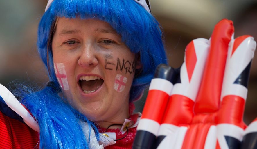 A England fan cheers while waiting for Canada and England to play a FIFA Women's World Cup quarter-final soccer game in Vancouver, British Columbia, on Saturday June 27, 2015. (Darryl Dyck/The Canadian Press via AP) MANDATORY CREDIT