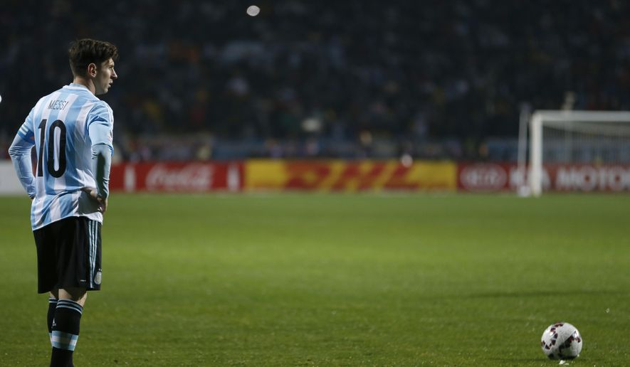 Argentina's Lionel Messi prepares to shoot a free-kick during a Copa America quarterfinal soccer match against Colombia at the Sausalito Stadium in Vina del Mar, Chile, Friday, June 26, 2015. Argentina defeated Colombia 5-4 on penalties after a 0-0 draw on Friday to reach the semifinals of the Copa America.(AP Photo/Andre Penner)