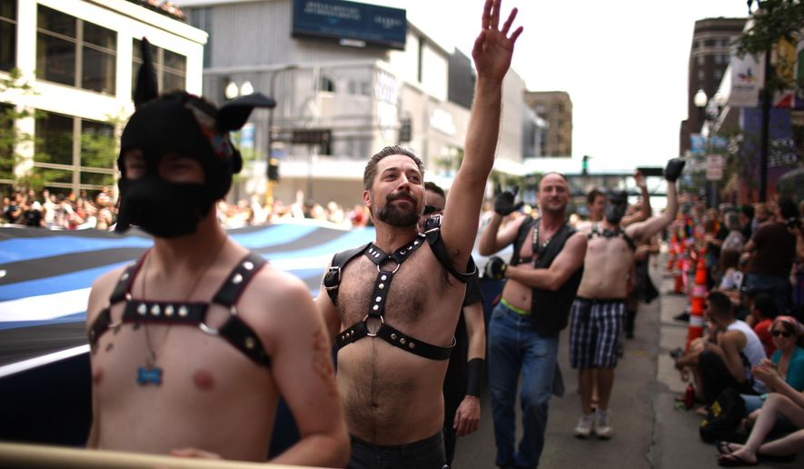 Revelers take part in the Gay Pride Parade in Minneapolis Sunday, June 28, 2015. A large turnout was expected for gay pride parades across the U.S. following the landmark Supreme Court ruling that said gay couples can marry anywhere in the country. (Jeff Wheeler/Star Tribune via AP)
