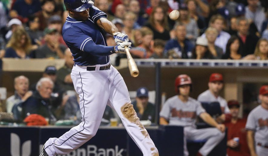 San Diego Padres' Justin Upton swings on a two-run home run against the Arizona Diamondbacks during the fifth inning of a baseball game Saturday, June 27, 2015, in San Diego.  (AP Photo/Lenny Ignelzi)