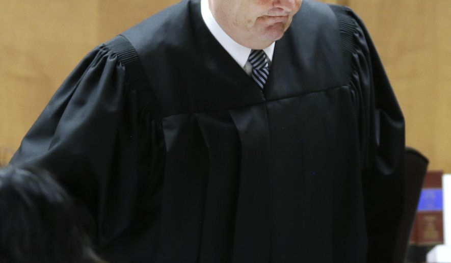 FILE - In a Thursday, June 25, 2015 file photo, Judge Larry Hendricks adjourns court after a hearing in Shawnee County District Court, in Topeka, Kan. Hendricks decision to block Kansas from banning a common second-trimester abortion procedure eventually could reshape the state's legal climate and intensify conservative Republicans' push to change how the highest court is selected. (AP Photo/Orlin Wagner, File)