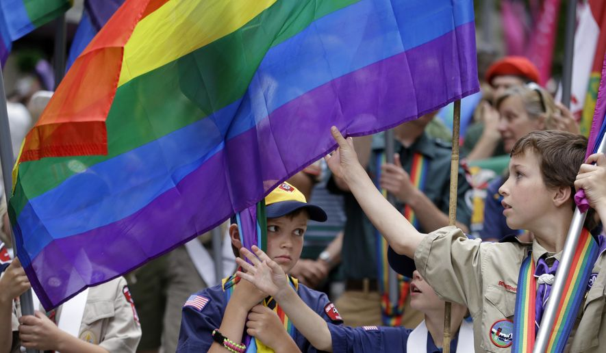 Scouts prepare their flags before leading marchers in the 41st annual Pride Parade Sunday, June 28, 2015, in Seattle. A large turnout was expected for gay pride parades across the U.S. following the landmark Supreme Court ruling that said gay couples can marry anywhere in the country. (AP Photo/Elaine Thompson)