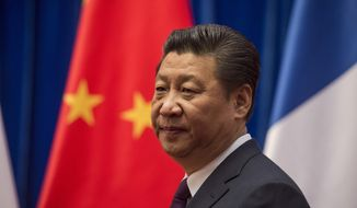 Chinese President Xi Jinping waits to welcome French Prime Minister Manuel at the Great Hall of the People in Beijing, Friday, Jan. 30, 2015. (AP Photo/Fred Dufour, Pool) ** FILE **