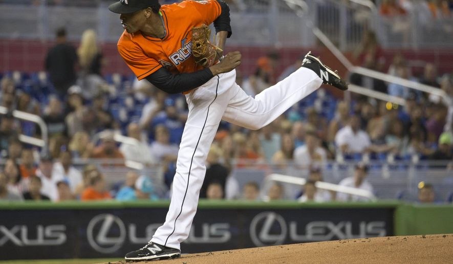 Miami Marlins pitcher Jose Urena throws to the Los Angeles Dodgers during the first inning of a baseball game in Miami, Sunday, June 28, 2015. (AP Photo/J Pat Carter)