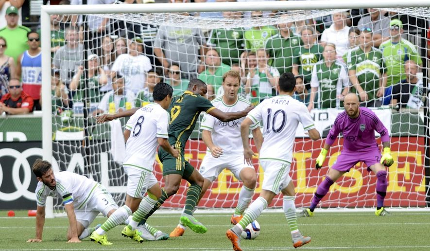 Seattle Sounders defenders Brad Evans (3), Gonazlo Pineda (8) and Marco Pappa (10) crowd against Portland Timbers' Fanendo Adi , third from left, during the first half of an MLS Soccer game in Portland, Ore., Sunday June 28, 2015. Sounders goalkeeper Stefan Frei is at right.  (AP Photo/Greg Wahl-Stephens)