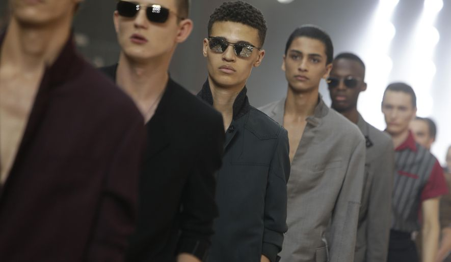 Models wear creations for Lanvin men's Spring-Summer 2016 fashion collection presented, Sunday, June 28, 2015 in Paris, France. (AP Photo/Thibault Camus)