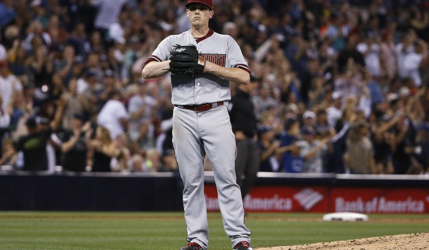 Arizona Diamondbacks starting pitcher Jeremy Hellickson waits while San Diego Padres' Justin Upton rounds the bases with a two-run home run during the fifth inning of a baseball game Saturday, June 27, 2015, in San Diego. (AP Photo/Lenny Ignelzi)