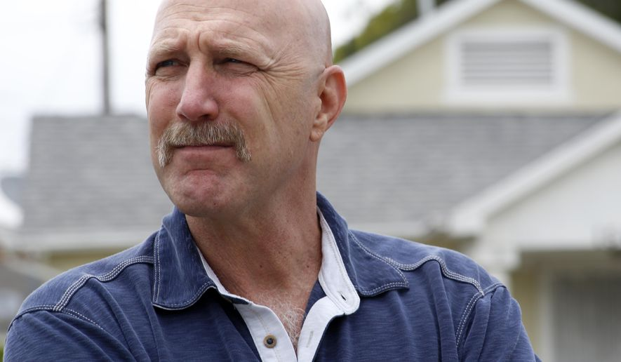 """In this Thursday, June 4, 2015 photo, David Klinger, professor of criminology and criminal justice at the University of Missouri-St. Louis, stands in a neighborhood in south-central Los Angeles where he used to work as a police officer. Although he'd never been in a fight in school or afterward _ """"I always have viewed trying to talk to people and reason with people as the best way to resolve things"""" _ Klinger concluded he could kill, if it meant he'd be saving the life of a fellow officer or innocent civilian. He would heed his training at the academy: """"You only shoot if you absolutely have to."""" (AP Photo/Martha Irvine)"""