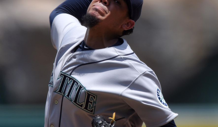 Seattle Mariners' Felix Hernandez throws to the plate during the first inning of a baseball game against the Los Angeles Angels, Sunday, June 28, 2015, in Anaheim, Calif. (AP Photo/Mark J. Terrill)