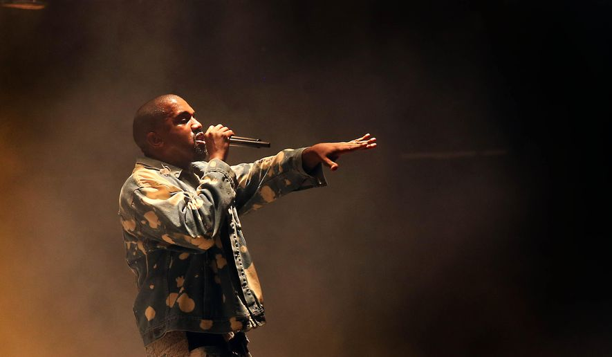 Kanye West performs on the main Pyramid stage during the Glastonbury music festival on Saturday, June 27, 2015 at Worthy Farm, Glastonbury, England. (Photo by Joel Ryan/Invision/AP)