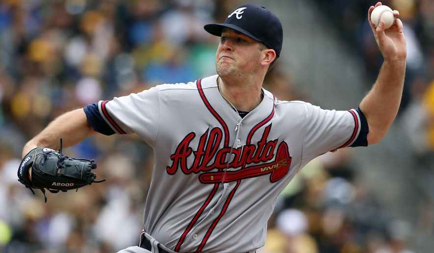 Atlanta Braves starting pitcher Alex Wood delivers in the first inning of a baseball game against the Pittsburgh Pirates in Pittsburgh, Sunday, June 28, 2015. (AP Photo/Gene J. Puskar)