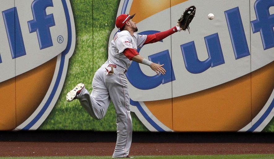 Cincinnati Reds center fielder Billy Hamilton cannot catch double hit by New York Mets' Steven Matz during the second inning of the baseball game at Citi Field, Sunday, June 28, 2015, in New York. (AP Photo/Seth Wenig)