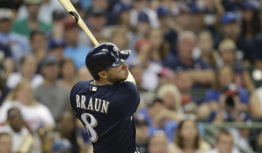Milwaukee Brewers' Ryan Braun watches his two-run home run against the Minnesota Twins during the eighth inning of a baseball game Sunday, June 28, 2015, in Milwaukee. (AP Photo/Jeffrey Phelps)