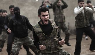 Syrian rebels attend a training session in Maaret Ikhwan near Idlib, Syria, on Dec. 17, 2012. (Associated Press) **FILE**