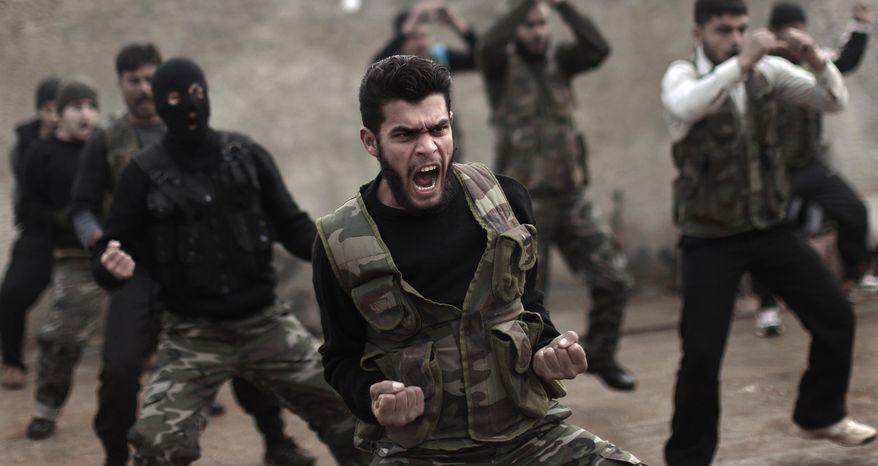 Syrian rebels attend a training session in Maaret Ikhwan near Idlib, Syria, on Dec. 17, 2012. (Associated Press) **FILE**