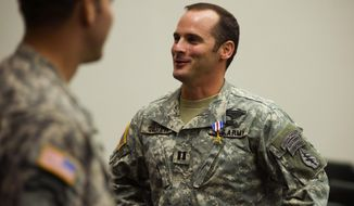 In this Jan. 4, 2011, file photo, U.S Army Capt. Mathew Golsteyn, right, is congratulated by fellow soldiers following the Valor Awards ceremony for 3rd Special Forces Group at Fort Bragg, N.C. (James Robinson/The Fayetteville Observer via AP) ** FILE **