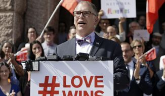 Jim Obergefell, the named plaintiff in the Obergefell v. Hodges Supreme Court case that legalized same sex marriage nationwide, is backed by supporters of the courts ruling on same-sex marriage on the step of the Texas Capitol during a rally Monday, June 29, 2015, in Austin, Texas. The Supreme Court declared Friday that same-sex couples have a right to marry anywhere in the United States. (AP Photo/Eric Gay