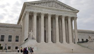 In this June 26, 2015, photo, people begin to enter the Supreme Court in Washington. Meeting on Monday, June 29, for the final time until the fall, the Supreme Court has three cases remaining to be decided (AP Photo/Jacquelyn Martin)