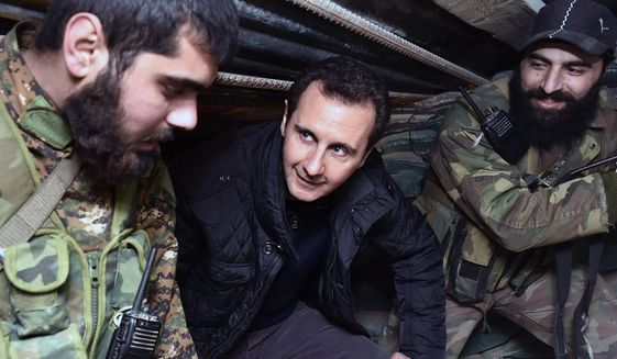 Syrian President Bashar Assad visits troops on the front line in Damascus. Officials said several jihadi factions, including the ruthless Islamic State, are gaining ground quickly against the regime's fighters in several parts of the nation. (Associated Press)