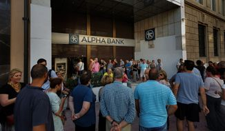 Anxious Greeks lined up at ATMs on Monday as they gradually began dispensing cash again on the first day of capital controls imposed in a dramatic twist in Greece's financial saga. Banks will remain shut until next Monday, and a daily limit of $67 has been placed on cash withdrawals from ATMs. (Associated Press)
