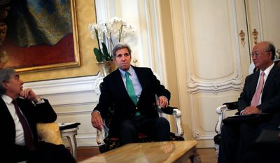 Secretary of State John F. Kerry sits between Secretary of Energy Ernest Moniz (left) and IAEA Director General Yukiya Amano during a meeting in Vienna, Austria.  (Associated Press)