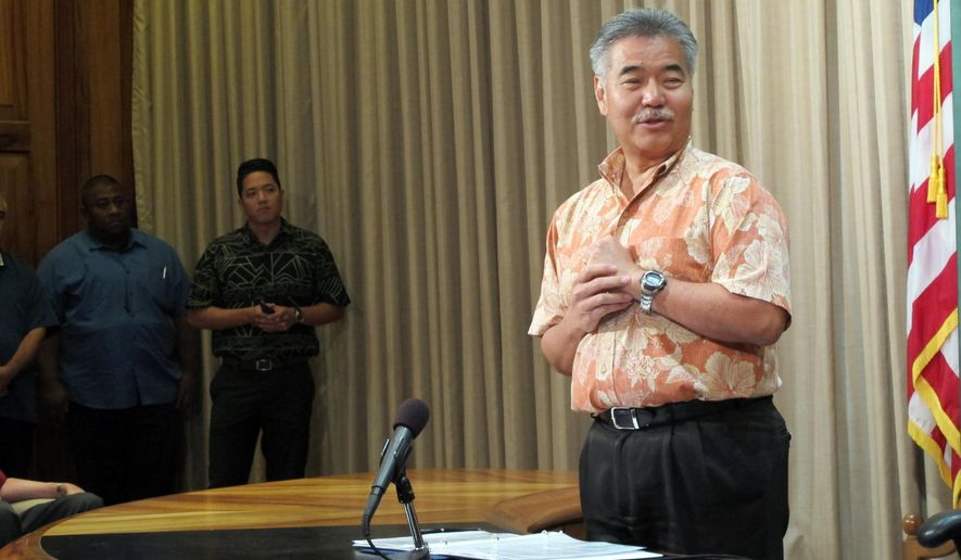 FILE- In this June 19, 2015, file photo, Hawaii Gov. David Ige speaks in Honolulu. Ige said he plans to veto a bill that would ban sex trafficking, making the state the only one in the nation without a comprehensive law on the subject. Ige announced the decision and other vetoes at a Monday, June 29, 2015, afternoon news conference. (AP Photo/Cathy Bussewitz, File)