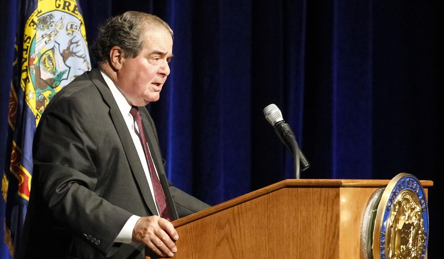 U.S. Supreme Court Justice Antonin Scalia gives the keynote speech at the Snake River Adjudication celebration dinner at the Boise Center on the Grove in Boise, Idaho, on Monday, August 25, 2014. (AP Photo/Otto Kitsinger)