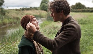 "Simone Kirby portrays Oonagh, left, and Barry Ward portrays Jimmy in a scene from ""Jimmy's Hall."" (Joss Barratt/Sony Pictures Classics via AP)"