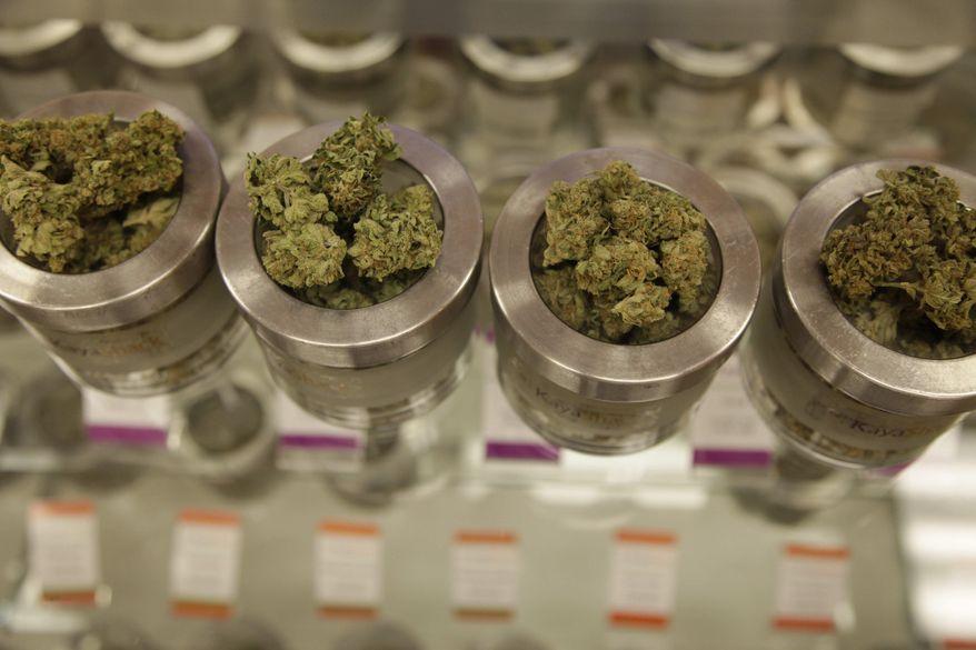 In this Friday, June 26, 2015, photo, different varieties of marijuana flowers are displayed at medical marijuana dispensary Kaya Shack in Portland, Ore. (AP Photo/Gosia Wozniacka)