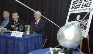 "The Russian Vice Consul to New York, Vage Engibarian, second left, speaks at the Cradle of Aviation Museum in Garden City, NY, Friday, Oct. 4, 2002. The museum commemorated the 45th anniversary of the launch of Sputnik. Looking on left is Paul Dickson, author of ""Sputnik, The Shock of the Century"", and Vincent Suozzi, right, former mayor of Glen Cove, NY. A model of Sputnik is in the foreground. (AP Photo/Ed Bailey)"