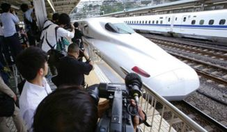 A Japanese bullet train comes to a stop for reporters. (Associated Press) ** FILE **