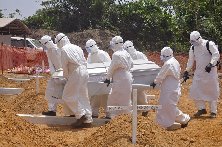 In this file photo taken on Wednesday, March 11, 2015, health workers carry a body of a person that they suspected died from the Ebola virus to a new graveyard on the outskirts of Monrovia, Liberia. The corpse of a 17-year-old man has tested positive for Ebola in Liberia, but no other cases have been reported, the country's deputy health minister said late Monday, June 29, 2015. (AP Photo/ Abbas Dulleh,File)