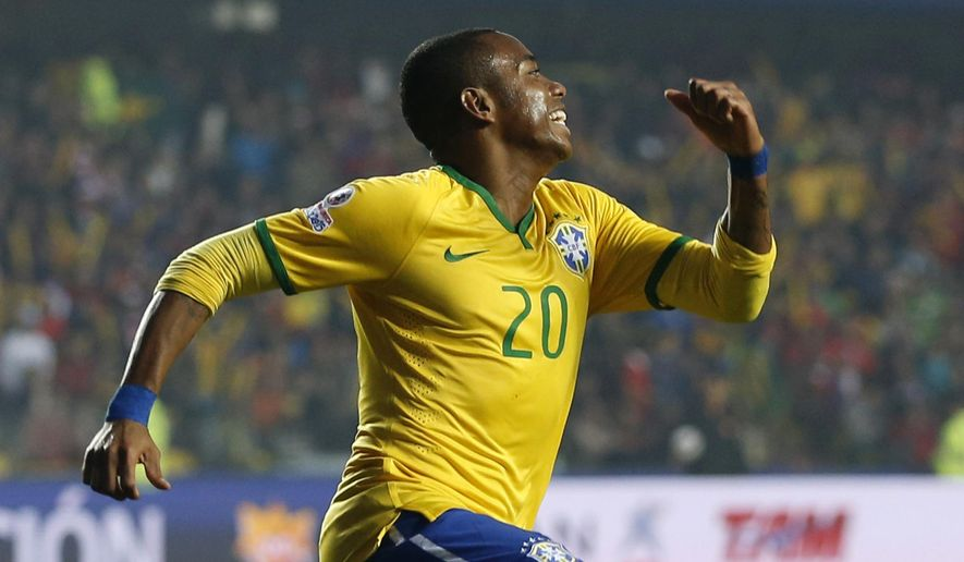 Brazil's Robinho celebrates after scoring the opening goal against Paraguay during a Copa America quarterfinal soccer match at the Ester Roa Rebolledo Stadium in Concepcion, Chile, Saturday, June 27, 2015. (AP Photo/Silvia Izquierdo)