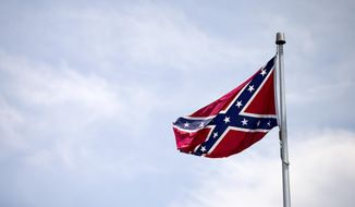 A Confederate flag flies at the base of Stone Mountain Tuesday, June 30, 2015, in Stone Mountain, Ga. (AP Photo/David Goldman)