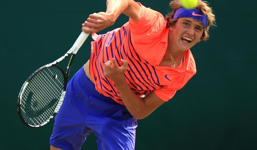 Alexander Zverev in action during his match with Novak Djokovic during day four of The Boodles at Stoke Park, near Stoke Poges, England, Friday June 26, 2015. (Mike Egerton/PA via AP)  UNITED KINGDOM OUT  NO SALES  NO ARCHIVE