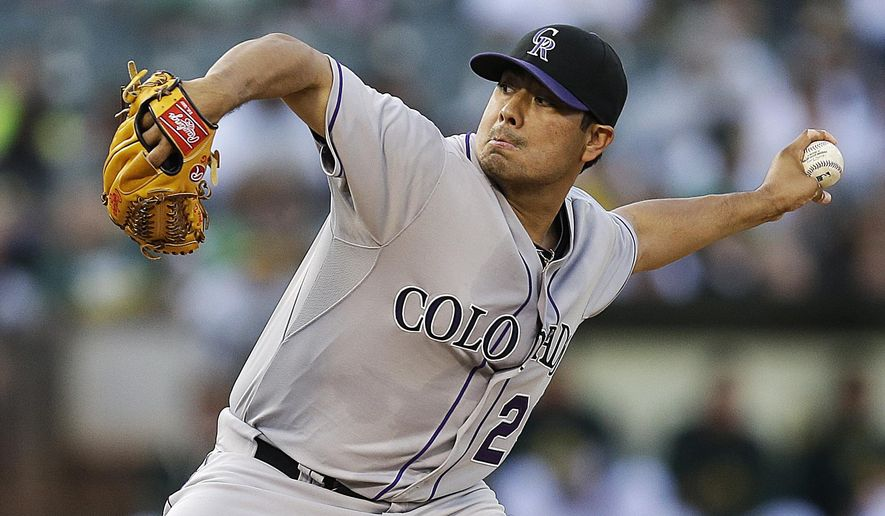 Colorado Rockies pitcher Jorge De La Rosa works against the Oakland Athletics in the first inning of a baseball game Tuesday, June 30, 2015, in Oakland, Calif. (AP Photo/Ben Margot)