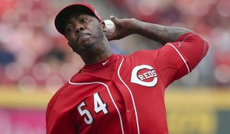 Cincinnati Reds relief pitcher Aroldis Chapman throws in the ninth inning of a baseball game against the Minnesota Twins, Wednesday, July 1, 2015, in Cincinnati. The Reds won 2-1. (AP Photo/John Minchillo)