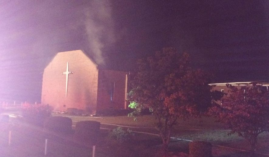 Smoke rises from Mount Zion African Methodist Episcopal church near Greeleyville, S.C., which caught fire Tuesday, June 30, 2015. Firefighters are trying to extinguish the blaze at the prominent black church. (Veasey Conway/The Morning News via AP)