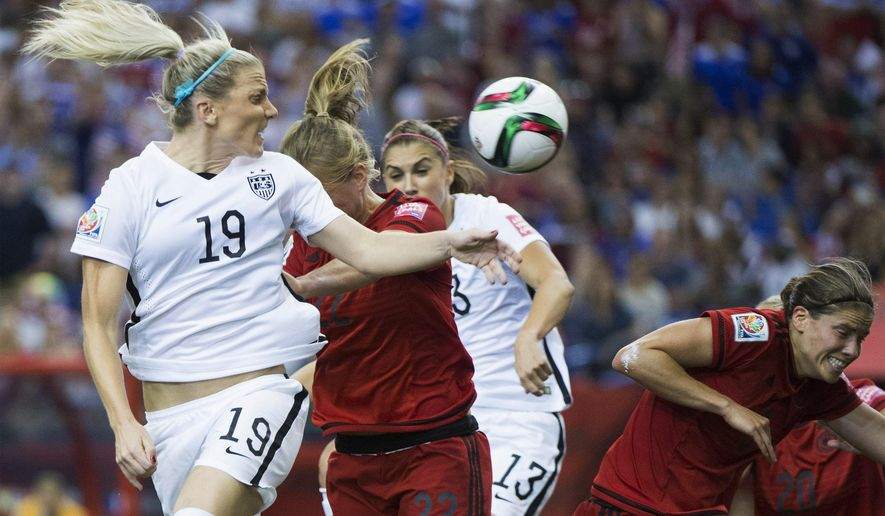 United States' Julie Johnston (19) heads the ball toward the goal as Germany players defend during the first half of a semifinal in the Women's World Cup soccer tournament, Tuesday, June 30, 2015, in Montreal, Canada. (Graham Hughes/The Canadian Press via AP)