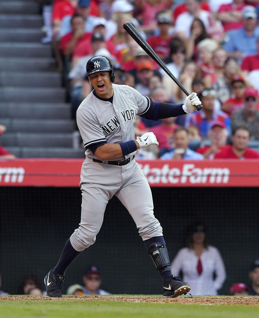 New York Yankees' Alex Rodriguez strikes out during the seventh inning of a baseball game against the Los Angeles Angels, Wednesday, July 1, 2015, in Anaheim, Calif. (AP Photo/Mark J. Terrill)