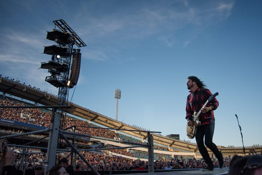 """D.C. Foo Fighters' fans worried Dave Grohl might need to sit out the Independence Day festival, need not fret. """"Can't [expletive] wait for the 4th!!! See you at home, DC,"""" the band tweeted Monday. (ASsociated Press)"""