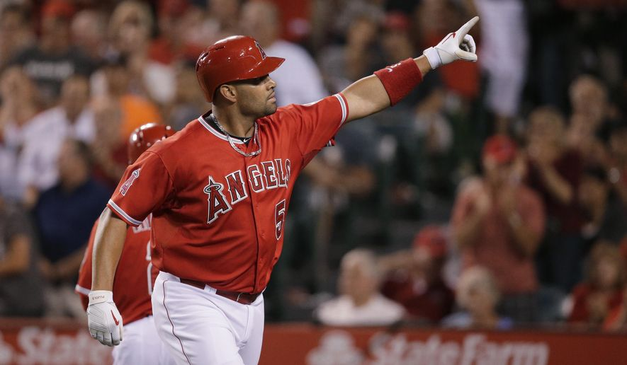 Los Angeles Angels' Albert Pujols celebrates his home run during the sixth inning of a baseball game against the New York Yankees, Tuesday, June 30, 2015, in Anaheim, Calif. (AP Photo/Jae C. Hong)