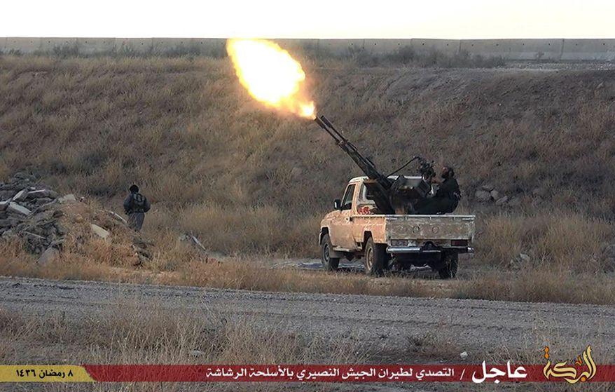 Islamic State militants open fire toward a Syrian warplane in the predominantly Kurdish Syrian city of Hassakeh, Syria. (Associated Press)