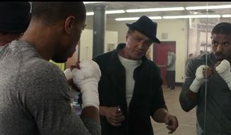 "Sylvester Stallone reprises his iconic ""Rocky"" role as a trainer to Apollo Creed's son, played by Michael B. Jordan in ""Creed."" (Image: YouTube, Warner Bros. Pictures) ** FILE **"