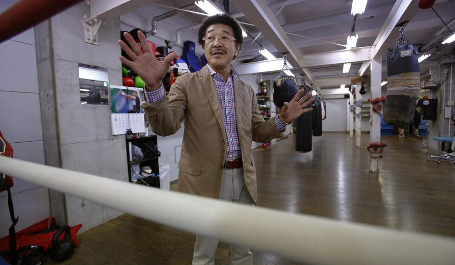 In this photo taken Monday, June 29, 2015, International Boxing Hall of Fame inductee, Yoko Gushiken speaks during an interview at his boxing gym in Tokyo.  Light flyweight champion Gushiken was inducted into the International Boxing Hall of Fame on Sunday, June 14.  Three decades after retiring from the ring - often feeling lost and depressed - and after a secondary career as a TV comedian, the former WBA light flyweight champion Gushiken now accepts his status as a legend in the sport.   (AP Photo/Shizuo Kambayashi)