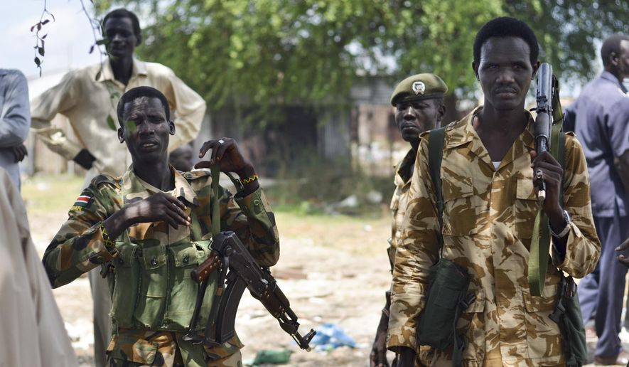 In this photo taken Wednesday, June 24, 2015, South Sudanese government soldiers patrol in Bentiu town, South Sudan. (AP Photo/Jason Patinkin) ** FILE **