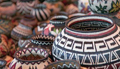 Handwoven baskets from the Wounaan National Congress in Panama at the International Folk Art Market in Santa Fe, N.M. This year's annual market begins July 10, 2015. (Stephanie Mendez/International Folk Art Market via AP)