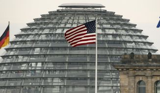 FILE - In this Oct. 25, 2013 file picture the US  flag flies  on top of the US embassy in front  of the  Reichstag building  that houses the German  Parliament, Bundestag, in Berlin,  A German official says Chancellor Angela Merkel's chief of staff has asked the U.S. ambassador for a meeting to discuss the latest reports of alleged U.S. spying on Germany. The official says chief of staff Peter Altmaier invited Ambassador John B. Emerson to the chancellery Thursday July 2, 2015.  (AP Photo/Michael Sohn,file)