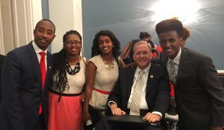 "Rep. Jim Langevin, Rhode Island Democrat, has introduced legislation to address the underground practice of adoptive families ""re-homing"" their children to new families or other places. Mr. Langevin was joined at a June 24, 2015, Capitol Hill event by (left to right) Tefera Alemayehu, who founded a network for family professionals and families; adoptee Addy Steinhoff, who was re-homed as a teen; adoptee Belaynesh Hehn, who was dropped off at a shelter as a teen; and adoptee Samuel Hehn, who was placed in an apartment until he turned 18. (Image courtesy of Maureen Flatley)"